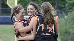 Members of the East Rockaway softball team celebrate