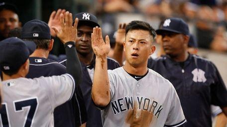 New York Yankees' Rob Refsnyder celebrates scoring on