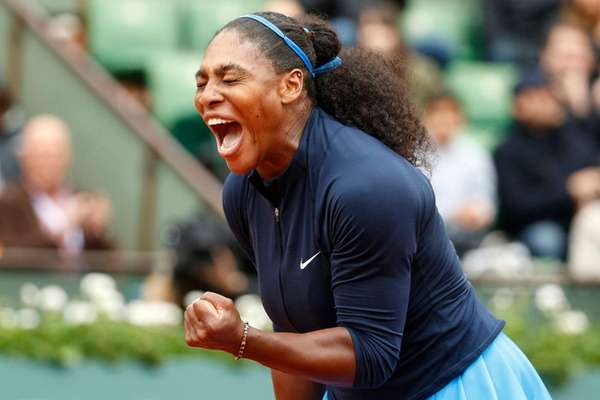 Serena Williams clenches her fist after scoring a
