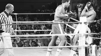 Muhammad Ali and his compatriot and titleholder George