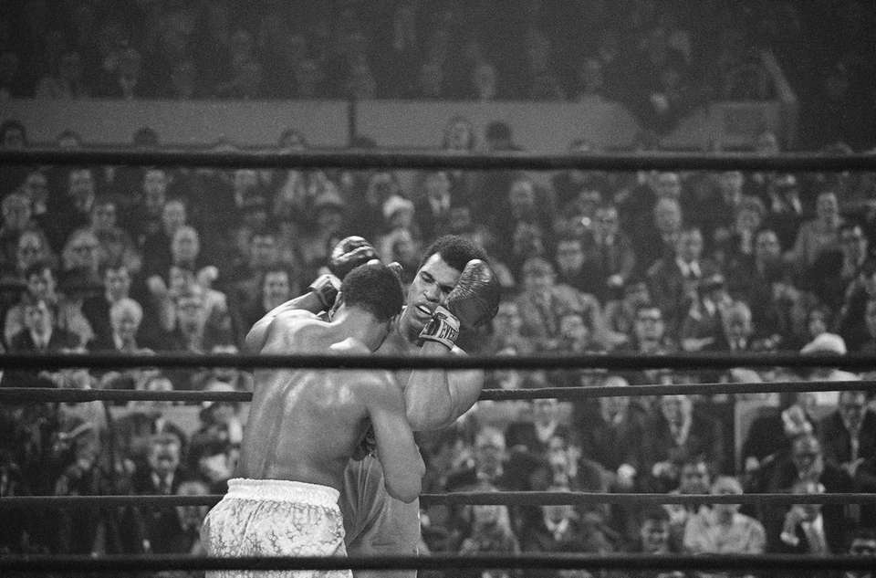 Heavyweight champion Joe Frazier, left, has challenged Muhammad