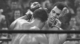 Heavyweight champion Joe Frazier, left, has challenged Muhammad