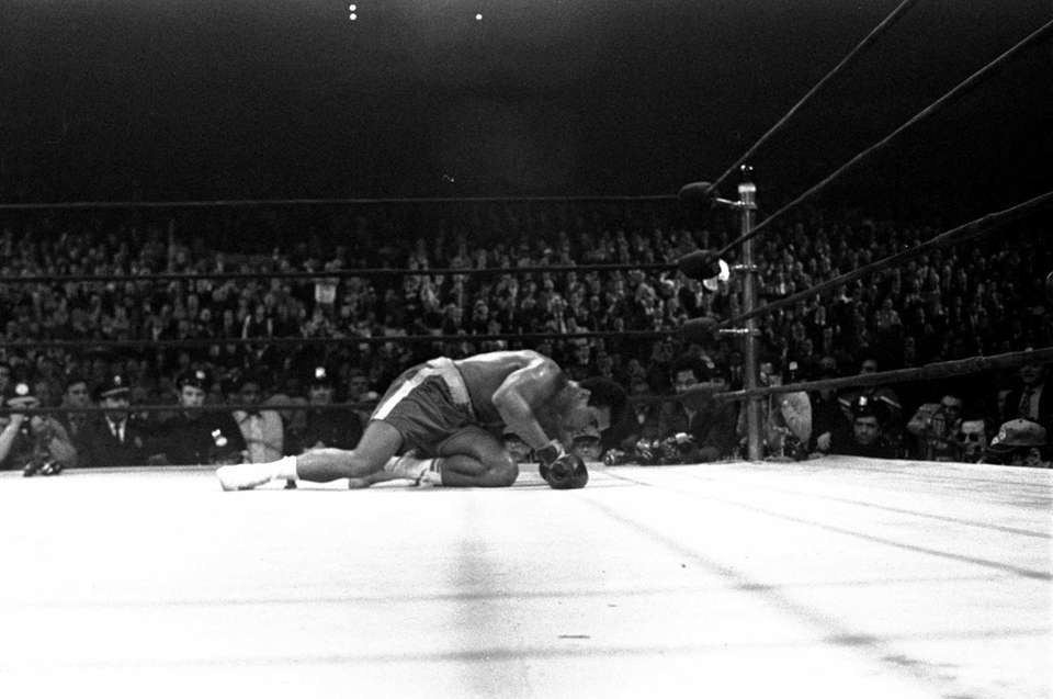 Muhammad Ali is down on the canvas after