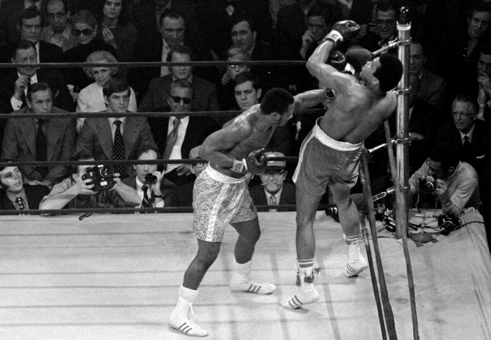 Joe Frazier lands a left to the jaw
