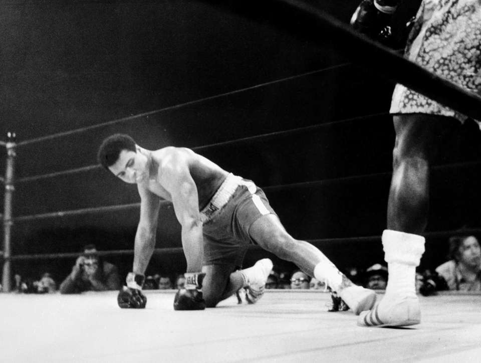 Muhammad Ali gets knocked down by Joe Frazier