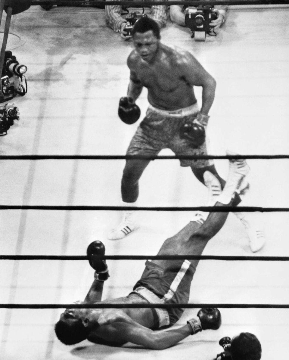 Heavyweight boxing champion Joe Frazier kept his title