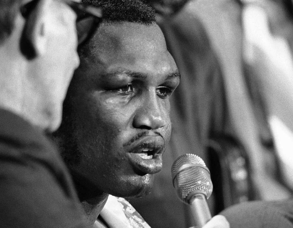 Joe Frazier, a little battered after his title