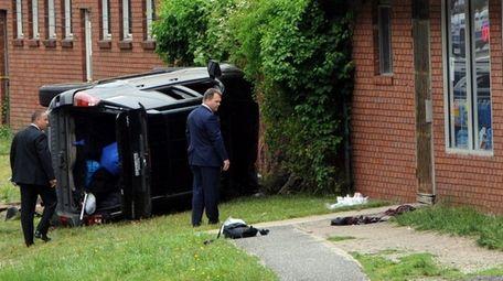 Suffolk County investigators look over the scene of