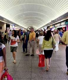 Commuters walk in the tunnel-like main hallway at