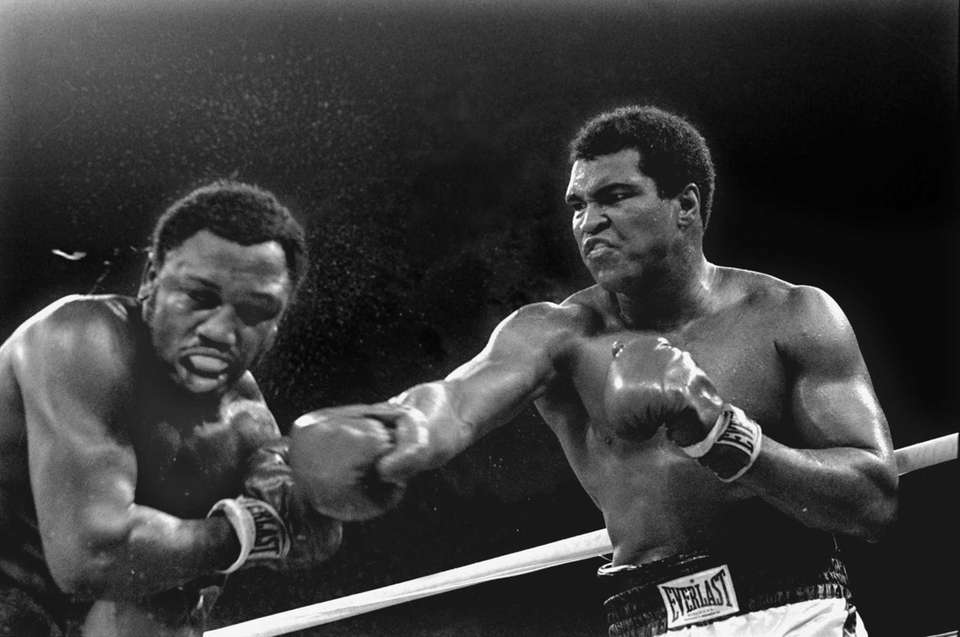Sweat flies from the head of Joe Frazier