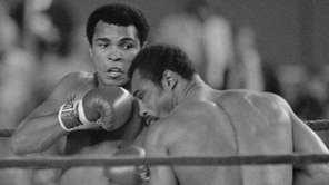 Heavyweight champion Muhammad Ali knocks challenger Ken Norton