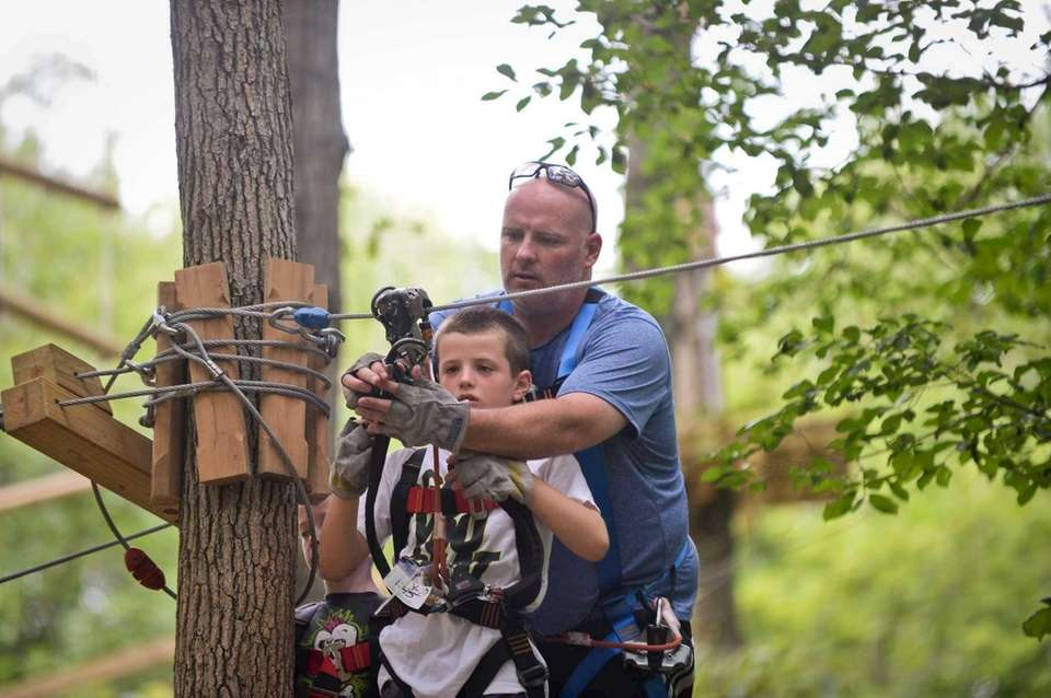 Dads can zip line for free, with a