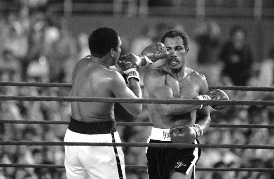Heavyweight champion Muhammad Ali takes a punch in
