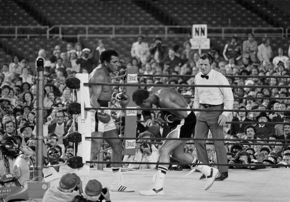 Ken Norton ducks down during his bout with