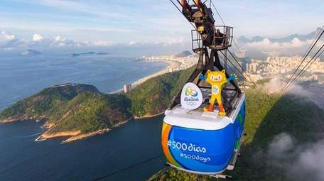 Olympics mascot Vinicius rides on a Sugarloaf Mountain