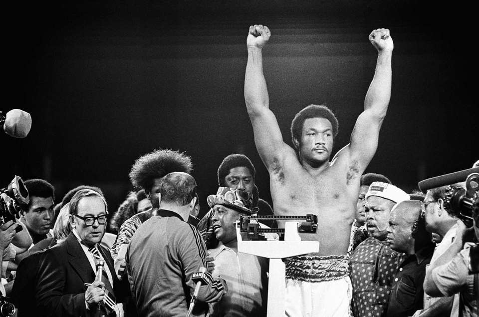 Heavyweight champion George Foreman responds to cheers of