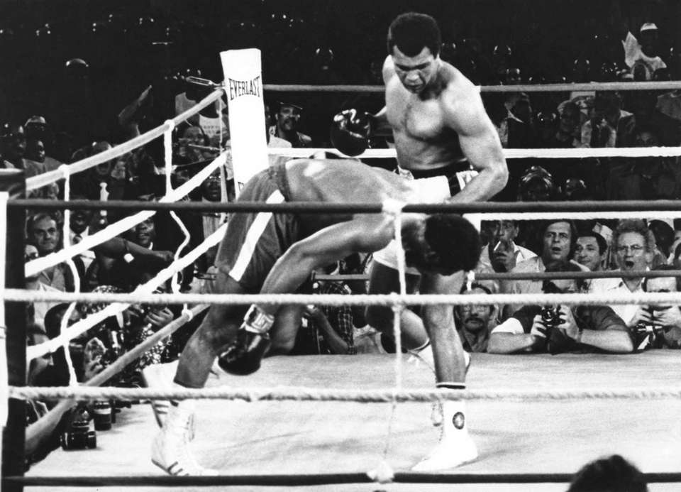 Muhammad Ali as he watches George Foreman head