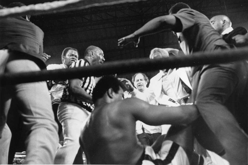 An exhausted Muhammad Ali falls to the canvas