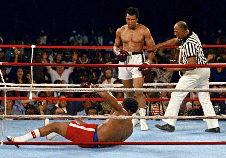 Referee Zack Clayton, right, steps in after challenger