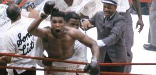 Muhammad Ali, known then as Cassius Clay, reacts