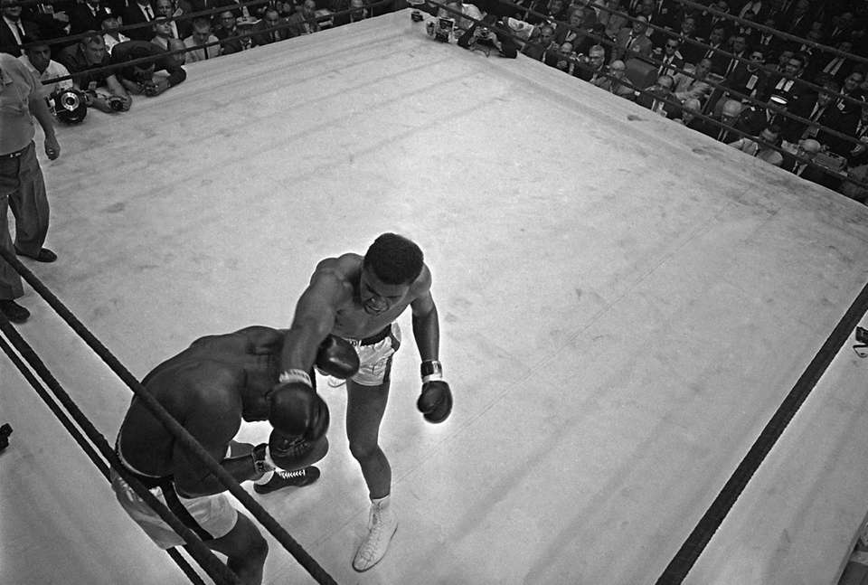 Muhammad Ali (Cassius Clay) backs Sonny Liston into