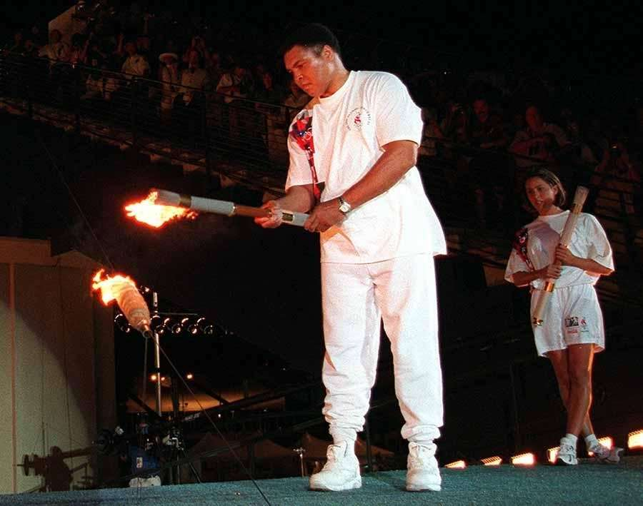 1996: In an emotional ceremony, Ali lights the