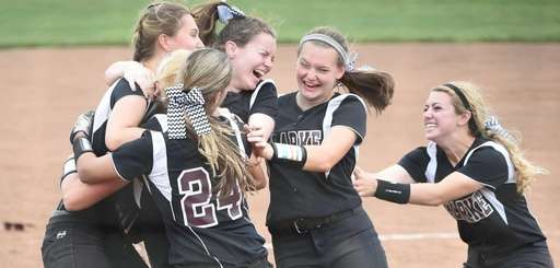 Clarke starting pitcher Sarah Cornell and teammates celebrate