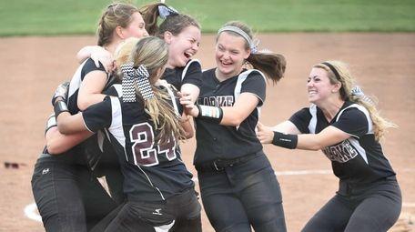 Clarke starting pitcher Sarah Cornell and teammates celebrate