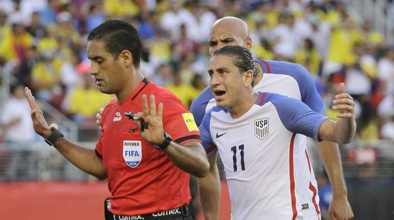 Alejandro Bedoya of the United States argues with