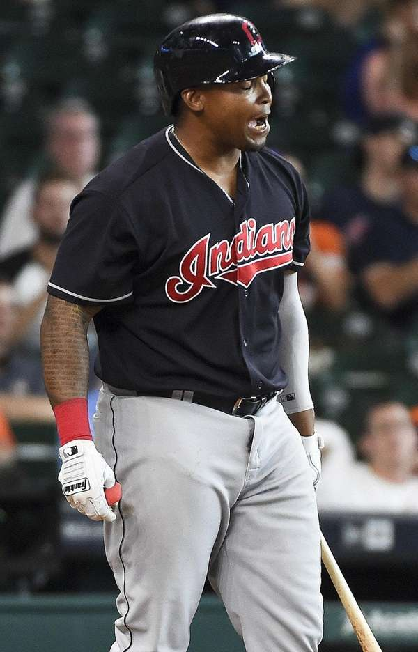 Cleveland Indians' Marlon Byrd reacts after striking out