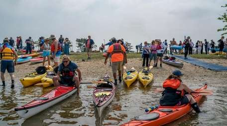 Kayakers take to the water on Saturday, June
