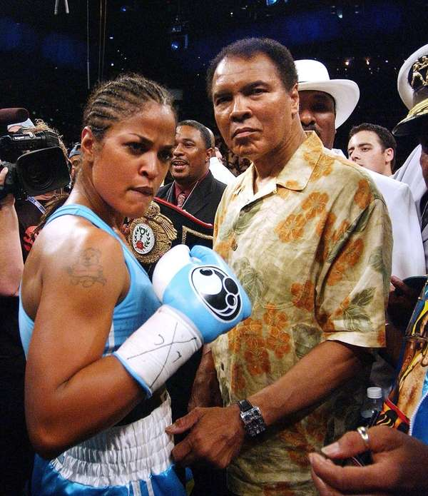 With her father Muhammad Ali by her side,