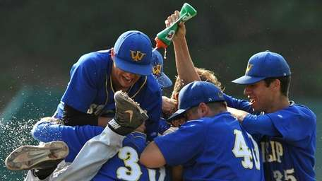 West Islip teammates celebrate after their 16-0 win