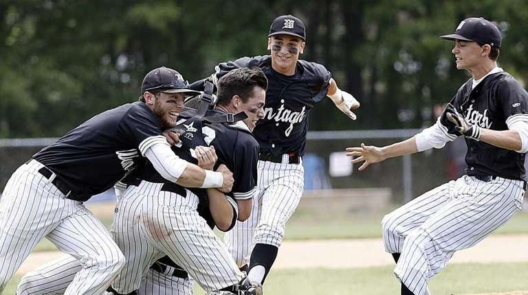 Wantagh players tackle their pitcher Bobby Hegarty at