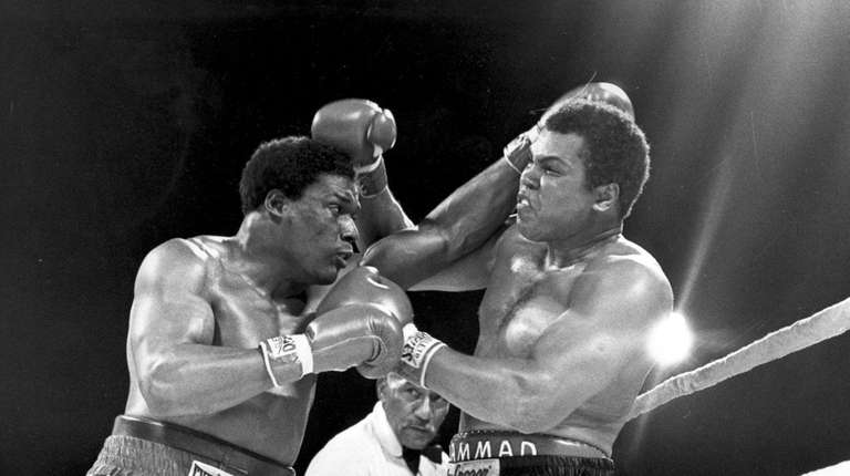 Muhammad Ali, right, takes a punch from Trevor