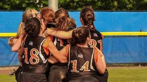 East Rockaway Softball team members celebrate on the
