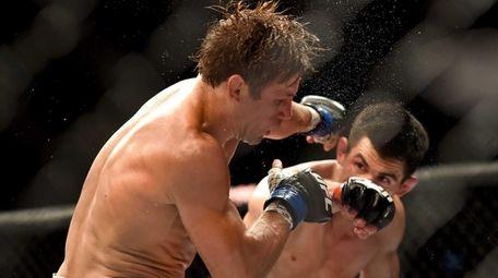 Urijah Faber, left, fights Dominick Cruz during a