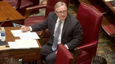 Sen. John DeFrancisco, R-Syracuse, works during session in