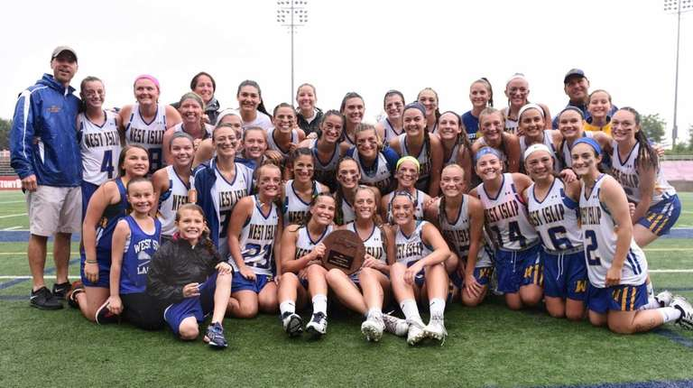 West Islip players and coaches pose for a