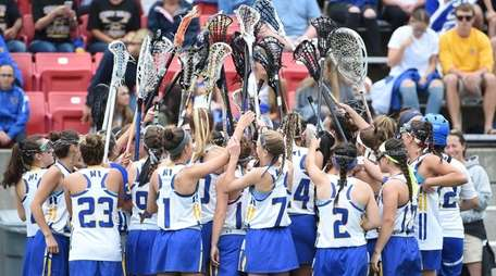 West Islip players huddle against Massapequa in the