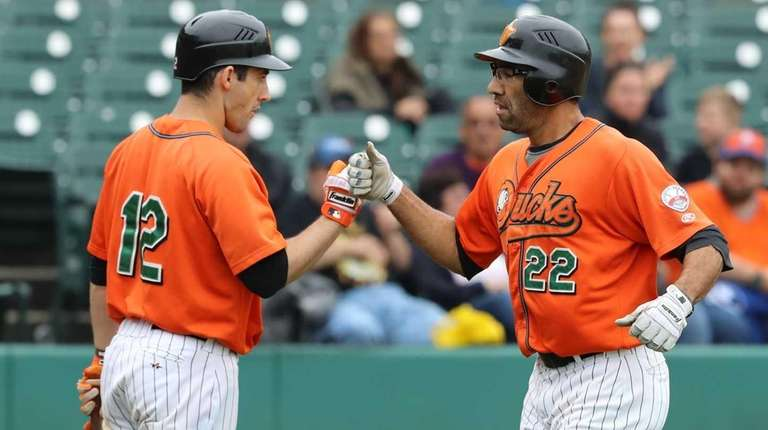 Ducks rightfielder Fehlandt Lentini #22 is greeted at