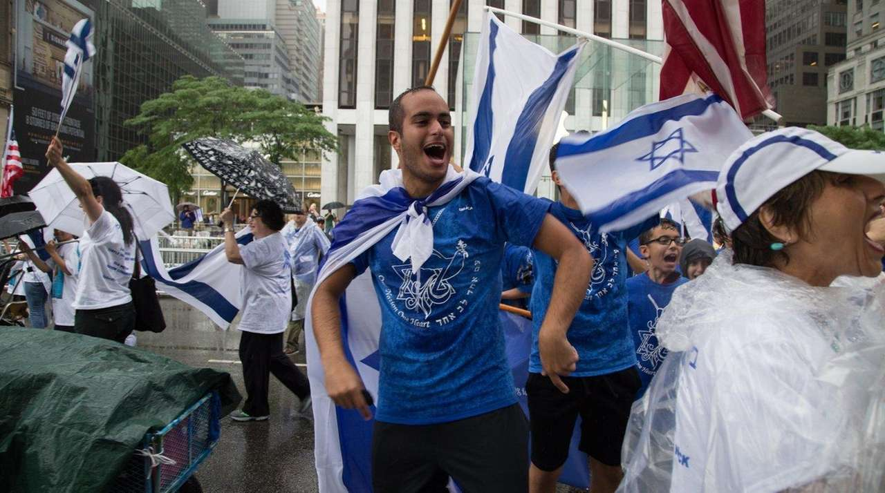 Festive marchers in the Celebrate Israel Parade walk