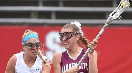 Garden City attacker Brooke McDaid is defended by