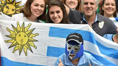 Supporters of Uruguay wait for the start of