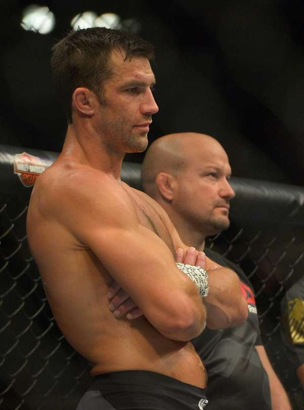 Luke Rockhold stands in the cage after he