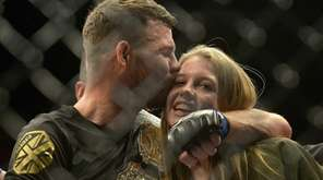 Michael Bisping hugs his daughter Ellie Bisping after