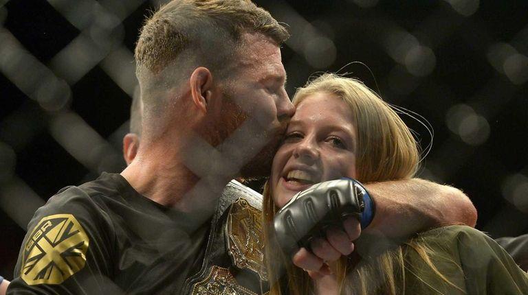 Michael Bisping hugs his daughter Ellie Bisping after
