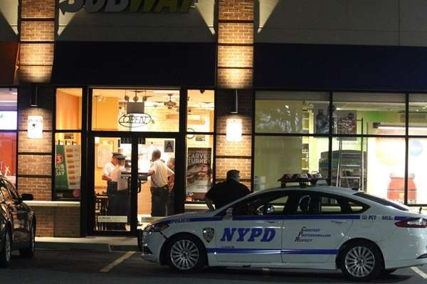 NYPD officers on Wednesday, June 1, 2016, investigate