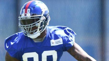 New York Giants defensive end Jason Pierre-Paul runs