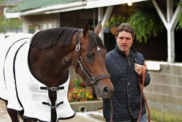 Trainer Keith Desormeaux walks Belmont Stakes hopeful Exaggerator